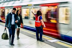 Dispatcher in London subway. LONDON, UNITED KINGDOM - MAY 14: Dispatcher in Westminster subway station on May 14, 2018 in London royalty free stock images
