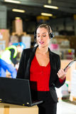 Dispatcher using headset at warehouse of forwardin Royalty Free Stock Image