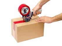 Dispensador de empaquetado del arma de la cinta Imágenes de archivo libres de regalías
