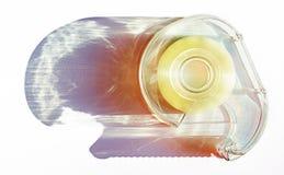 Dispensador de la cinta adhesiva con la sombra larga Foto de archivo libre de regalías