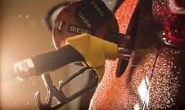 Dispensador de la gasolina en el coche Imágenes de archivo libres de regalías