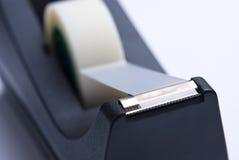 Dispensador pegajoso negro de la cinta Imagen de archivo