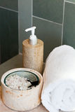 Dispenser, bath salt and towel Royalty Free Stock Photos