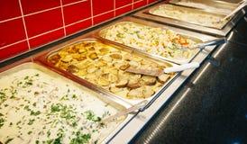 Dispenser. Of fresh salads in restaurant stock photos