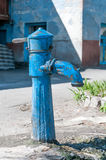 Dispenser. Old courtyard. Pump for water Royalty Free Stock Photos