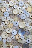 Dispersado em botões de matéria têxtil Imagens de Stock Royalty Free