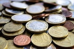 Dispersed euro coins of silver and gold. A large number of coins symbolize wealth, wealth, income and profits. Foreground royalty free stock photography