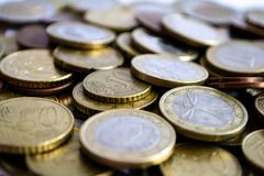 Dispersed euro coins of silver and gold. A large number of coins symbolize wealth, wealth, income and profits. Foreground stock photography
