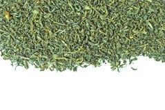 Dispersión del té verde aislada en blanco Fotos de archivo