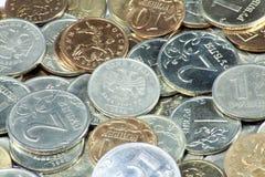 Dispersione delle monete Immagine Stock