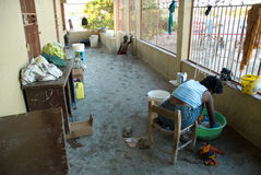 Displaced Families. September 26, 2008 - Women try to wash clothing in a  church in Gonaives, Haiti, where they and hundreds of others fled to escape the Royalty Free Stock Image