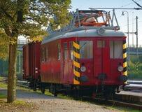 Displaced old train electric waggon. Displaced old red train electric waggon Stock Photo