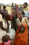 Displaced people receiving aid distribution. Stock Photography
