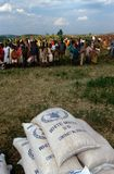 Displaced people waiting for aid distribution. People await a distribution by the WFP in Burundi royalty free stock images