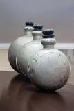 Display of 3 antique metal drug bottles.tif Stock Photos