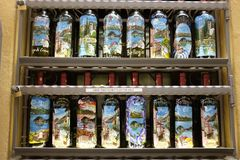 Bottles on display outside a shop in Bellagio, Lake Como. A display of bottle decorated with views of Bellagio outside a souvnirs shop Stock Photo