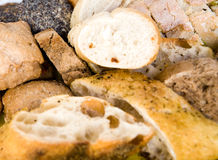 Display of breads. A closeup view of a food display with a variety of baked goods and breads Stock Photo