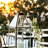 Display candles and glass lanterns for outdoor decor stock photo