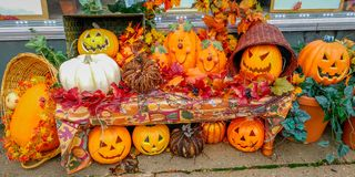 Display of Carved Pumpkins in Waterford, Wisconsin. A display of cute Jack-O-Lanterns, carved pumpkins sat up in the downtown area of Waterford, Wisconsin stock photo