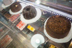 Display case with chocolate cakes Stock Photo