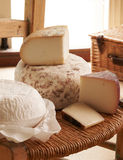 Display Of Cheese On Rustic Chair Royalty Free Stock Photography