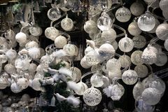Display of Christmas baubles and decoration on sale at Christmas market. Stall stock images