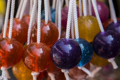 Display of Clackers. Display of colored glittery clackers Stock Photography