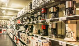 Display of coffee machines. VENDENHEIM, FRANCE - APRIL 6, 2017: Display of kitchen appliances such as coffee machines or microwaves in a french electrical goods Royalty Free Stock Images