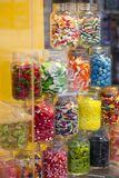 Display of colorful candy in large glass jars stock photography