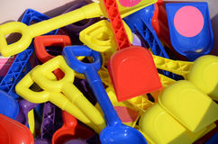 Display of colourful children spades. A display of colourful childrens spades Stock Photo