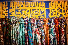 Display of colourful silk national scarves royalty free stock photo