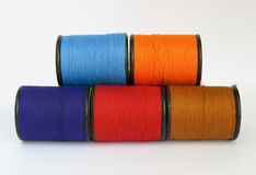 Display of colourful thread in spool Royalty Free Stock Photo