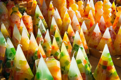 Display of cone shaped colorful wax candles Stock Photo