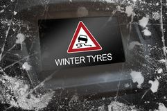 Display in the dashboard with attention winter tyres royalty free stock photo