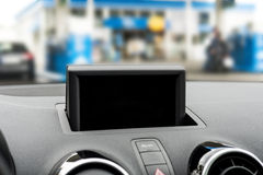 Display at a dashboard in a car with blurred background Stock Photos