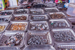 Display of different sized finger rings placed on plates in a street shop for sale, Chennai, India, Feb 19 2017 Royalty Free Stock Images