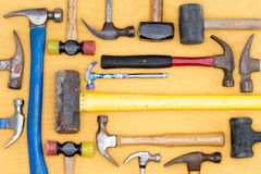 Display of a diversity of hammers in a tool kit. For DIY, carpentry, construction, mallets and a sledgehammer in a neat arrangement on a wooden table, overhead Stock Photography