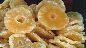 Display of Dried, Candied Pineapple Rings. Dried, lightly sugared pineapple rings for sale at Mahane Yehuda market in Jerusalem Royalty Free Stock Photography