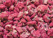 Display of dried pomegranate at a market stall Stock Images