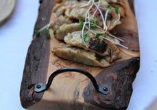 Dumplings dipped in peanut sauce on a wooden board Royalty Free Stock Image