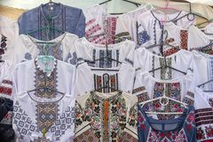 Display of embroidered Ukrainian slavic women and men traditional shirts embroidery clothing in outdoor flea market in Lviv, Ukrai. Ne. Close up. Ethnic texture stock photos