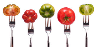 Display with five different tomatoes Stock Images