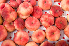Display of flat or doughnut peaches Royalty Free Stock Image