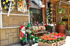 Display of flower shop containing flowers and garden gnomes Stock Photos