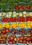 Display of fresh produce tomatoes and peppers Royalty Free Stock Image