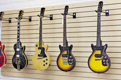 Display of guitars in a guitar store Stock Photo
