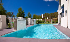 Display Home Pool 1. A pool with two waterfalls set against an azure sky Royalty Free Stock Photos