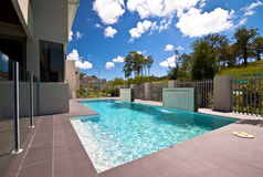 Display Home Pool 2. A pool with two waterfalls set against an azure sky Stock Photos