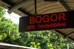 Display information board hanging on ceiling showing train to Bogor will entering the station soon photo taken in. Jakarta Indonesia java royalty free stock photography