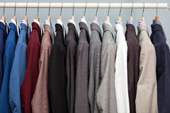 Display of man suits in a closet Royalty Free Stock Image